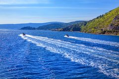 Motorboat ride. Trail on the blue water surface stock photography