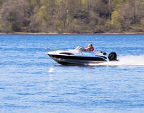 Motorboat on the river. On the background of forest - high speed stock images