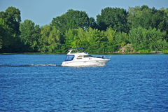 Motorboat on the river. Motorboat on the Dnieper river, Kiev, Ukraine stock photography