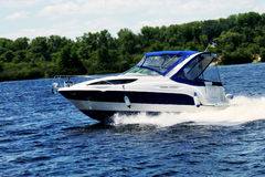 Motorboat on the river. Pleasure boat royalty free stock photography