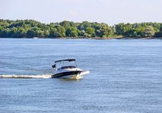 Motorboat on the river. In summer royalty free stock images