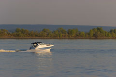 Motorboat on the route. Blue sea landscape royalty free stock image