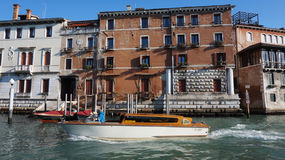Motorboat is sailing on Grand Canal in Venice, Italy Stock Photos