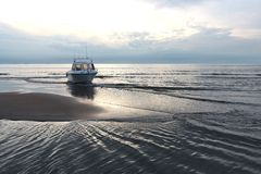 Motorboat. On sandbank at sunset royalty free stock image