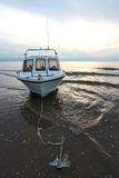 Motorboat. On sandbank at sunset royalty free stock photo