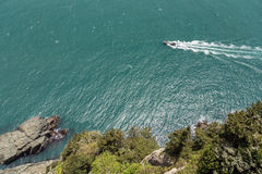 Motorboat, sea and rocky coastline viewed from above. View of a fast motorboat, ocean and rocky coastline from above at the Taejongdae Resort Park in Busan stock images