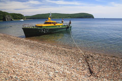 Motorboat in shore of Russian island. Far East, Russia royalty free stock image