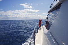 Motorboat side view with  window ocean reflection Stock Images