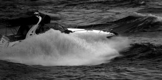 Motorboat splash in Black and White. Big wave from a boat on East River in black and white royalty free stock image
