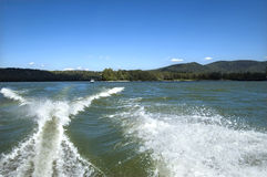 Motorboat splash and wake. On the river Stock Photos
