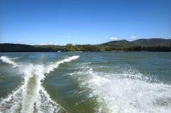 Motorboat splash and wake stock photos