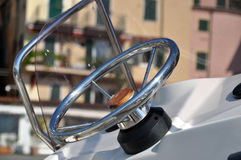 Motorboat steering wheel. Motorboat in the harbor steering wheel detail Stock Photo
