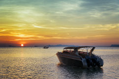 Motorboat at sunset. Beautiful landscape Royalty Free Stock Photos