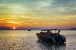Motorboat at sunset. Beautiful landscape Royalty Free Stock Photos