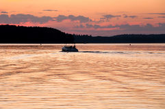 Motorboat at the sunset. Motorboat on the lake, Masurian Lake District royalty free stock photo