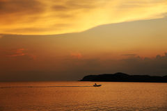 Motorboat at Sunset Stock Images
