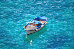 Motorboat swinging on water of Tyrrhenian sea, Ischia island - Italy Stock Photo