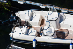 Motorboat top view. Top view of motorboat docked on pier with 60 horsepower engine stock images