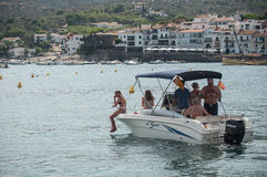 Motorboat with tourists in the port. CADAQUES - Spain - 16 August 2017 - motorboat with tourists in the port royalty free stock photo