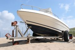 Motorboat. On trailer at sandy beach stock photography