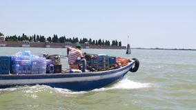 Motorboat transporting food, providing humanitarian aid to flooding victims stock video