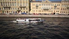 Motorboat travelling in town Film Tilt. Tracking shot St. Petersburg stock video footage
