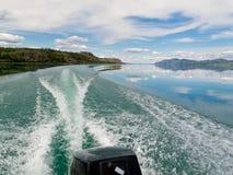 Motorboat Trip on Lake Laberge, Yukon T., Canada. Wake of fast outboard motorboat on beautiful Lake Laberge, Yukon Territory, Canada stock photos