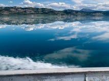 Motorboat Trip on Lake Laberge, Yukon T., Canada. Spray of fast motorboat on beautiful calm Lake Laberge, Yukon Territory, Canada royalty free stock photography