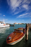 Motorboat in Venice. A motorboat in Venice with historic buildings in the background Royalty Free Stock Photo