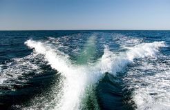 Motorboat wake. A wake of a powerful motor boat travelling at tremendous speed royalty free stock photos