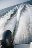 Motorboat wake. A wake of a powerful motor boat travelling at tremendous speed. The motor visible stock images
