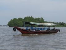 Motorboat, on which tourists will be taken on a trip to the Mekong Delta.Vietnam royalty free stock photo