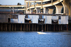 Motorboat on the Willamette River with old docks concrete overpa Stock Photography