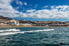 Motorboating in the deep-blue waters off the west coast of Tenerife, one of many leisure activities offered to tourists in the Can. Motorboating off the west royalty free stock image