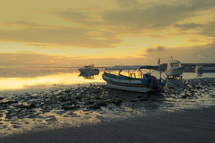 Motorboats on the beach of Nusa Dua at sunrise Stock Photo