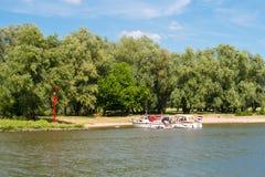 Motorboats on river Afgedamde Maas near Woudrichem, Netherlands Stock Photos