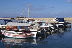 Motorboats in The Venetian port or old harbor of Chania, Greece Royalty Free Stock Photos