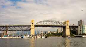 The boating scene at vancouver`s port. Motorboats and yachts as seen on the pacific coast of british columbia stock photos