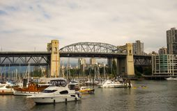 The boating scene at vancouver`s port. Motorboats and yachts as seen on the pacific coast of british columbia stock photo