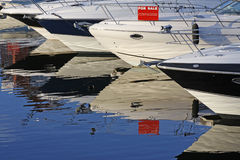 Motorboats and yachts for sale. Moored in a marina Stock Photography