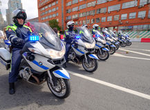 Motorcade of police motorcyclists is accompanied by a bicycle parade Royalty Free Stock Images
