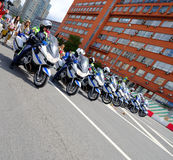 Motorcade of police motorcyclists is accompanied by a bicycle parade Royalty Free Stock Photo