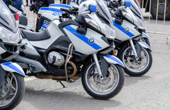 Motorcade of police motorcyclists is accompanied by a bicycle parade Stock Photo