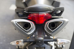 Motorcicle. Motorcycle viewed from the rear area where the exhaust pipes are observed royalty free stock photos