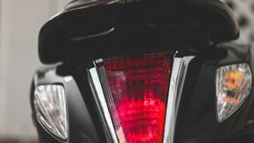 Motorcicle tail lights on a street. Motorsport. Wallpaper royalty free stock photo
