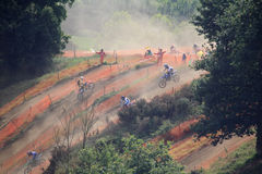 Motorcross in the dust. Motorcross competitors in the dust Stock Photo