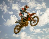 Aerial jump during a motocross race. Motorcross first evolved in the U.K. from motorcycle trials competitions, such as the Auto-Cycle Clubs`s first quarterly stock images