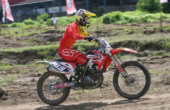 Motorcross. Motocross racers are spurring his motorcycle on the circuit in Sukoharjo, Central Java, Indonesia Royalty Free Stock Photography
