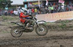 Motorcross. Motocross rider racing on a circuit in Sukoharjo, Central Java, Indonesia Royalty Free Stock Photo