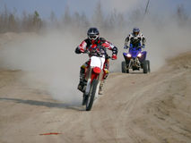 Motorcross race. Nadim, Russia, - May 29, 2008: Strange to think themselves are driving sports cars on the road Royalty Free Stock Photography